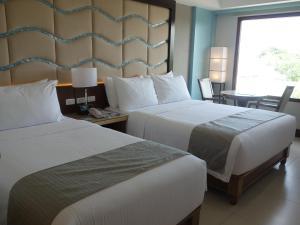 Ein Zimmer in der Unterkunft Henann Resort Alona Beach