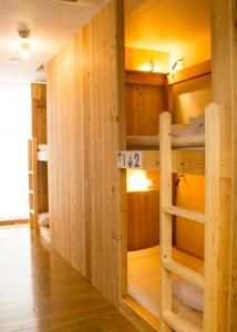 A bunk bed or bunk beds in a room at The Evergreen Hostel 長期ステイ歓迎