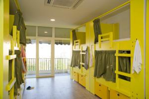 A bunk bed or bunk beds in a room at Marco Polo Party Hostel