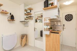 A kitchen or kitchenette at Notre-Dame luxury Suite in Saint-germain des prés Latin quarter