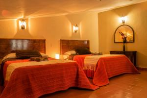 A room at Hotel Posada Dominnycos