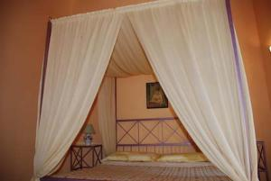 A bed or beds in a room at Terrauzza Sul Mare