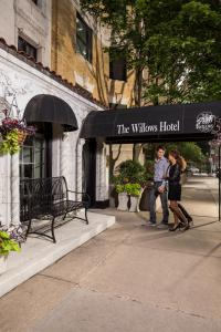 A porch or other outdoor area at The Willows Hotel
