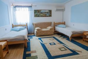 Кровать или кровати в номере Hotel VITA