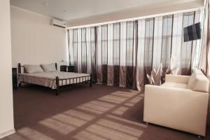 Гостиная зона в гостиница Меридиан