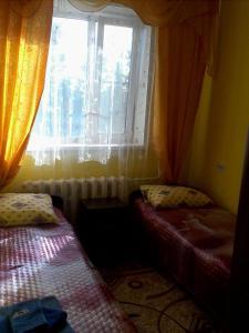 Кровать или кровати в номере Аmto Mil'kovo