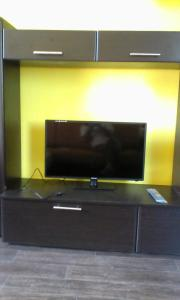 A television and/or entertainment center at Аmto Mil'kovo