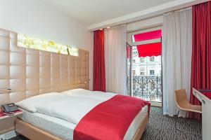 Ein Bett oder Betten in einem Zimmer der Unterkunft Hotel St.Gotthard