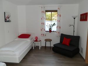 Ferienwohnung Aschauer tesisinde bir oda