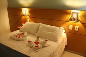 Cama ou camas em um quarto em Pousada Lua Azul