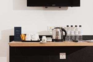 Coffee and tea-making facilities at Gold3 Boutique Hotel