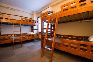 A bunk bed or bunk beds in a room at Khaosan Tokyo Kabuki