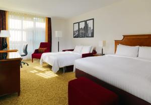 A bed or beds in a room at Hamburg Marriott Hotel