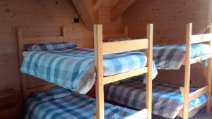 A bunk bed or bunk beds in a room at Rifugio Zoia