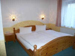 Ein Bett oder Betten in einem Zimmer der Unterkunft Landhaus Christoph