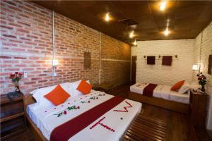 A room at Teak Wood Hotel