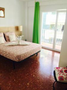 Una habitación en Axarquia Apartments