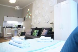 A bed or beds in a room at Concept Apartments