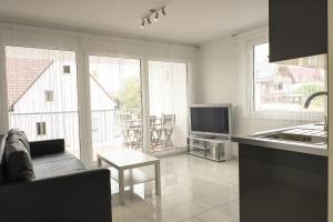 Ein Sitzbereich in der Unterkunft Design Apartment Metzingen