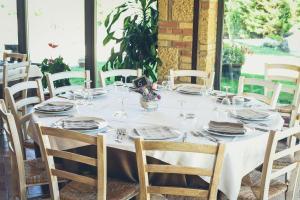 Een restaurant of ander eetgelegenheid bij Agriturismo La Collina
