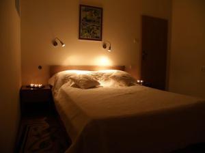 Łóżko lub łóżka w pokoju w obiekcie Centrum Konferencyjno-Hotelowe Alex