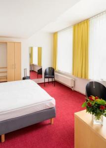 Ein Zimmer in der Unterkunft CVJM Düsseldorf Hotel & Tagung