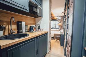 A kitchen or kitchenette at La suite heart of le Marais - quartier des enfants rouges
