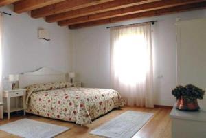 Postel nebo postele na pokoji v ubytování Agriturismo Di La' Dal Fiume