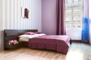 A bed or beds in a room at Royal Court Legerova