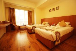 A room at Hotel Tarayana Grand