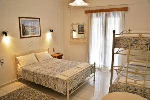 Ένα ή περισσότερα κρεβάτια σε δωμάτιο στο Grammatoula