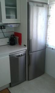 Una cocina o zona de cocina en Bermejo Apartamento