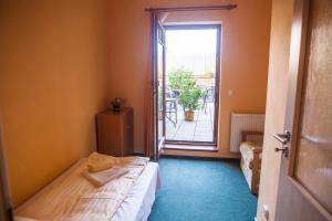 Postel nebo postele na pokoji v ubytování Penzion Černej pták