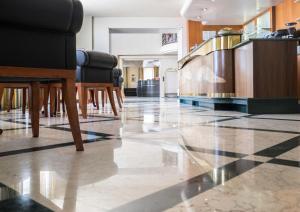 Лобби или стойка регистрации в PHI Hotel Astoria