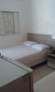 A bed or beds in a room at Hotel Porto Seguro