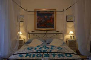 Letto o letti in una camera di B&B Vicolo del Chiostro