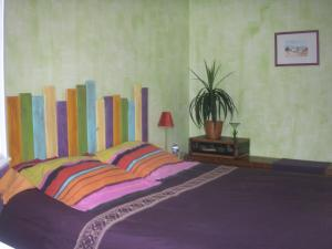 A bed or beds in a room at Les Illates