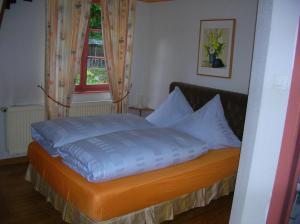 Un ou plusieurs lits dans un hébergement de l'établissement Hotel-Restaurant du Windstein
