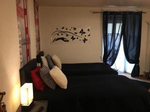 Ein Zimmer in der Unterkunft Au P'tit Bonheur