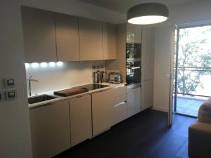 A kitchen or kitchenette at Tropezienne Deluxe Apartment
