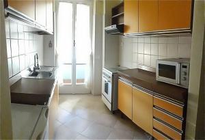 A kitchen or kitchenette at Studio 16 Apartment