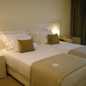 Uma cama ou camas num quarto em INLIMA Hotel & Spa