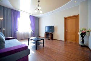A television and/or entertainment center at Five Stars on Lenina 30
