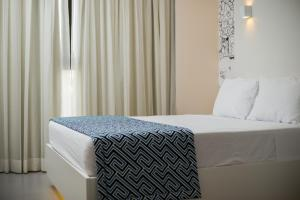 A bed or beds in a room at Ibis Styles Boa Vista