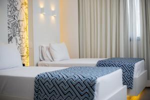 Cama ou camas em um quarto em Ibis Styles Rondonopolis