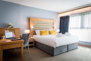 A bed or beds in a room at Radisson BLU Hotel & Spa, Little Island Cork
