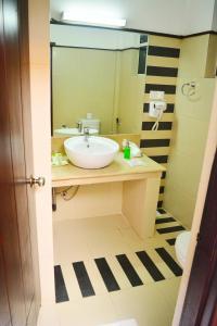 A bathroom at Unique Cottages