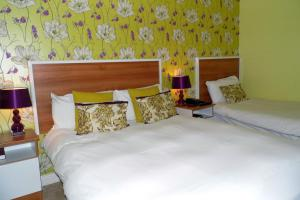 A bed or beds in a room at Creevy Pier Hotel