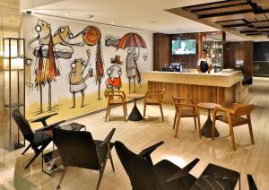 The lounge or bar area at Arena Ipanema Hotel
