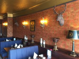 A restaurant or other place to eat at Parkstone Hotel